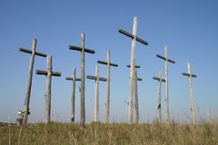 Group of crosses. On a hill of blue sky Royalty Free Stock Image
