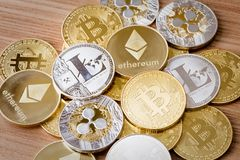 Crypto Currency. A group of crypto currency coins including Bitcoin, Litecoin, Ripple and Ethereum on an background stock photography