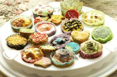 Group of cupcakes and biscuits Royalty Free Stock Images
