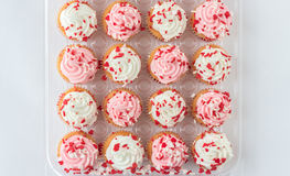 Group of cupcakes with pink and white frosting on top Stock Image