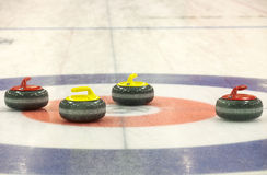 Group of curling rocks on ice Royalty Free Stock Image