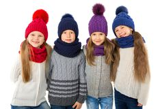 Group of cute kids in winter warm hats and scarfs  on white. Children winter clothes. Group of cute kids in winter warm hats and scarfs  on a white background Royalty Free Stock Image