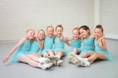 Group of cute little ballet dancers having fun at dance school class. stock images