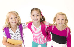 Group of Cute little girls going to school stock photo