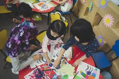 Group of cute little preschool kids drawing Royalty Free Stock Images