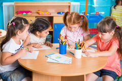 Group of cute little prescool kids drawing Royalty Free Stock Photo