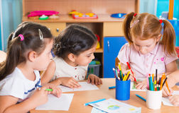 Group of cute little prescool kids drawing Stock Photo