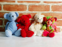 A group of cute teddy bears sitting together against with wallpaper Royalty Free Stock Photography