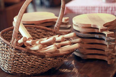 Group of cutting boards and wooden rolling pin in the basket Royalty Free Stock Photos