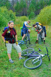 Group of cycle tourists stopped for rest in wood Stock Photo