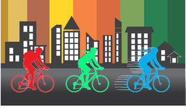Group of cyclist in the bicycle race with color building silhouette Royalty Free Stock Photos