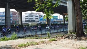 A group of cyclist on Chulalongkorn Day stock video footage