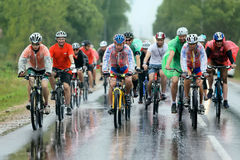 A group of cyclist racer racing  in the rain Royalty Free Stock Photo