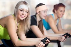 Group of cyclist women in gym Stock Photography