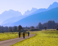 Group of cyclists biking in mountains Stock Images