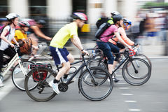 Group of cyclists in the city in motion blur Stock Images
