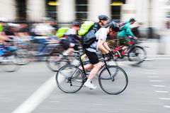 Group of cyclists in the city in motion blur Royalty Free Stock Images