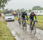 Group of Cyclists on a Cobblestone Road - Tour de France 2014 Stock Photos