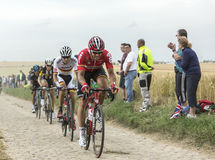 Group of Cyclists on a Cobblestone Road - Tour de France 2015 Stock Photo