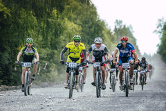 group of cyclists long downhill Royalty Free Stock Photography