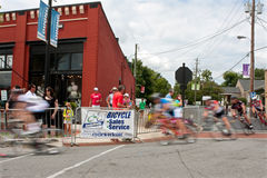 Group Of Cyclists Motion Blur In Turn Of Bike Race Stock Photos