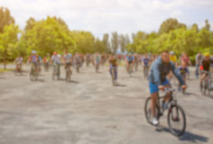 A group of cyclists organized a summer arrival on bikes on the road. Royalty Free Stock Photography