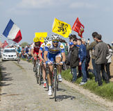 Group of Cyclists- Paris Roubaix 2014. Carrefour de l'Arbre,France-April 13,2014:The Belgian cyclist Edward Theuns (Topsport Vlaanderen-Baloise Team) riding in Royalty Free Stock Photos