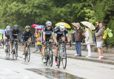 Group of Cyclists Riding in the Rain - Tour de France 2014 Stock Photography