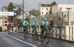 Group of Cyclists from Team Astana - Paris-Nice 2018 stock photo