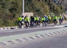 Group of cyclists on winter morning trains on intercity road Stock Photo
