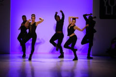 Group of dancers performs at opening of the New York Life fashion show during MBFW Fall 2015 Royalty Free Stock Image