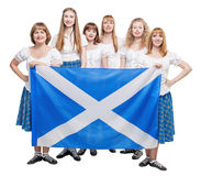 Group of dancers of Scottish dance with Scotland flag. Isolated royalty free stock image