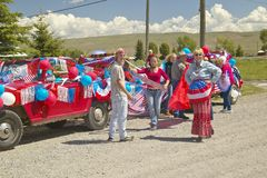 Group decorating a car in red, white & blue in Lima Montana Stock Images