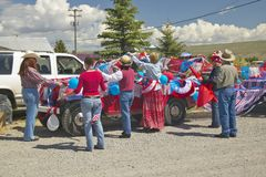 Group decorating a car in red, white & blue in Lima Montana Royalty Free Stock Images