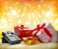 Group decorative gift boxes Golden bokeh front view Royalty Free Stock Image