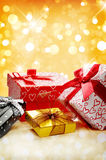 Group decorative gift boxes Golden bokeh front view vertical com Royalty Free Stock Photo
