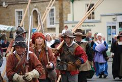 Group of People in Costume at a Fair, England, UK royalty free stock images