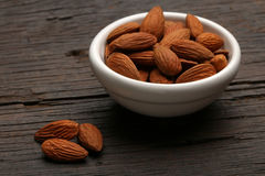 Group of delicious almonds in a bowl Stock Image