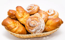 Group of delicious cinnamon rolls in basket isolated Royalty Free Stock Photography