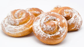 Group of delicious cinnamon rolls icing sugar isolated Royalty Free Stock Photography