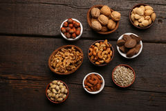Group of delicious dried fruits over a wooden background Stock Image
