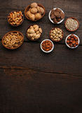 Group of delicious dried fruits over a wooden background Stock Photos