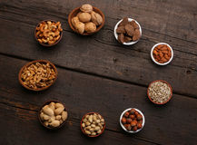 Group of delicious dried fruits over a wooden background Royalty Free Stock Photo