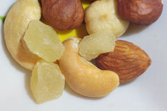 Group of delicious nuts and candied fruit closeup. Cashew, almond, hazelnut Stock Photography