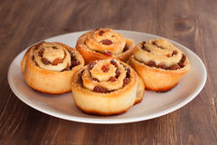 Group of delicious swirl buns with raisins and brown sugar Royalty Free Stock Images
