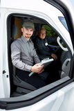 Group of delivery man in a car. Royalty Free Stock Photo