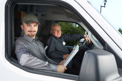 Group of delivery man in a car. Stock Photo