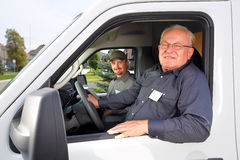 Group of delivery man in a car. Stock Photography