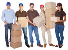Group of delivery people with boxes Stock Image