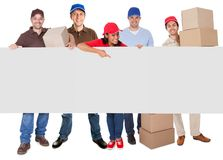 Group of delivery people presenting banner Royalty Free Stock Image